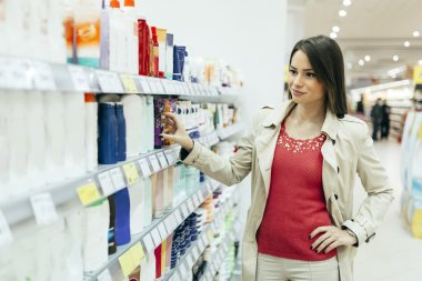 Woman buying body care products