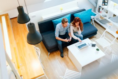 Couple working together in living room