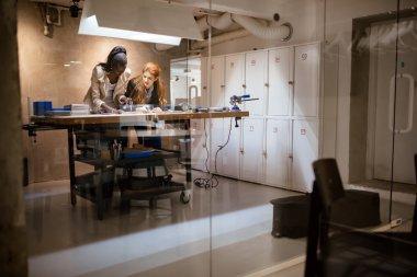 People working in modern workshop