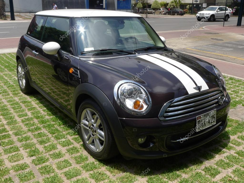 Burgundy and white color Mini Cooper parked in San Isidro district of Lima