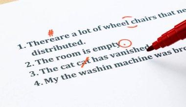 english sentences and correcting symbols on white sheet
