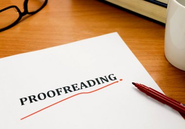 proofreading word on white sheet with red pen