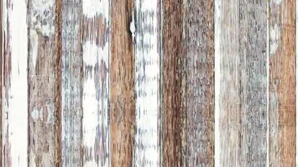 4K Nahtlose Looping-Bewegung schnell bewegten Hintergrund aus Grunge verwitterten alten Holzplanken Textur. Natürliche Alterung im Freien unter Sonne und Regen. Vertikale Bewegung von oben nach unten Video.