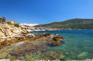 Cobalt blue Aegean sea, mountains and rocks on the island of Samos
