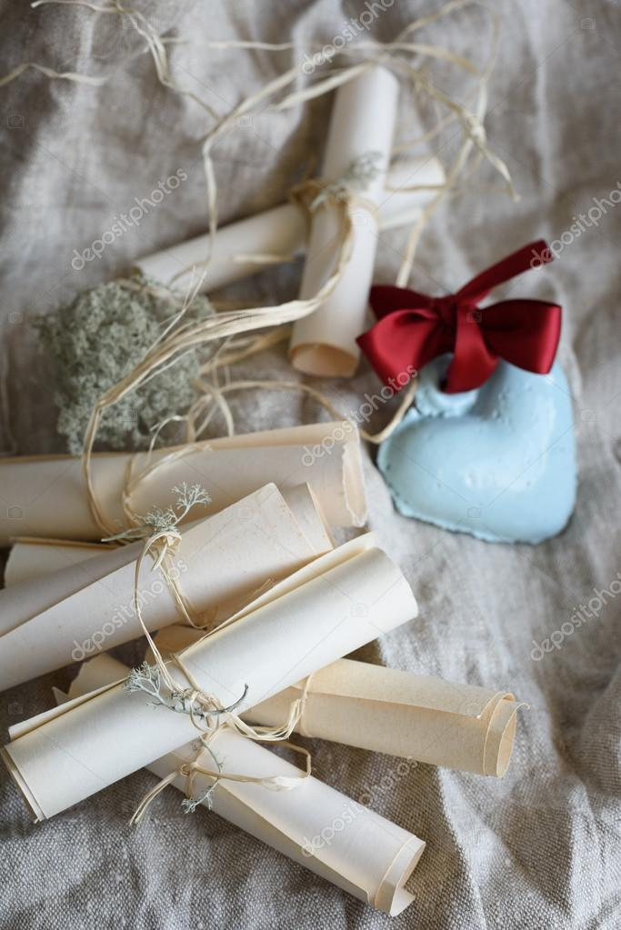 wedding vintage paper invitation scrolls and blue ceramic heart with