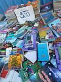 YANGON, BURMA - DECEMBER 23, 2013 - Closer View of Used Books on Sidewalk Booksellers table