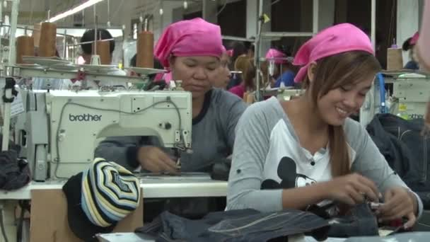 Asian Garment Industry Factory: MS female garment workers at sewing tables