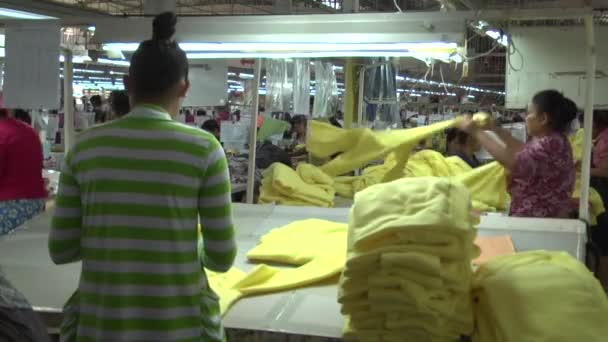 Textile Garment Factory Workers: MS green worker sorts yellow garments
