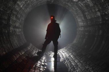 Man in underground river