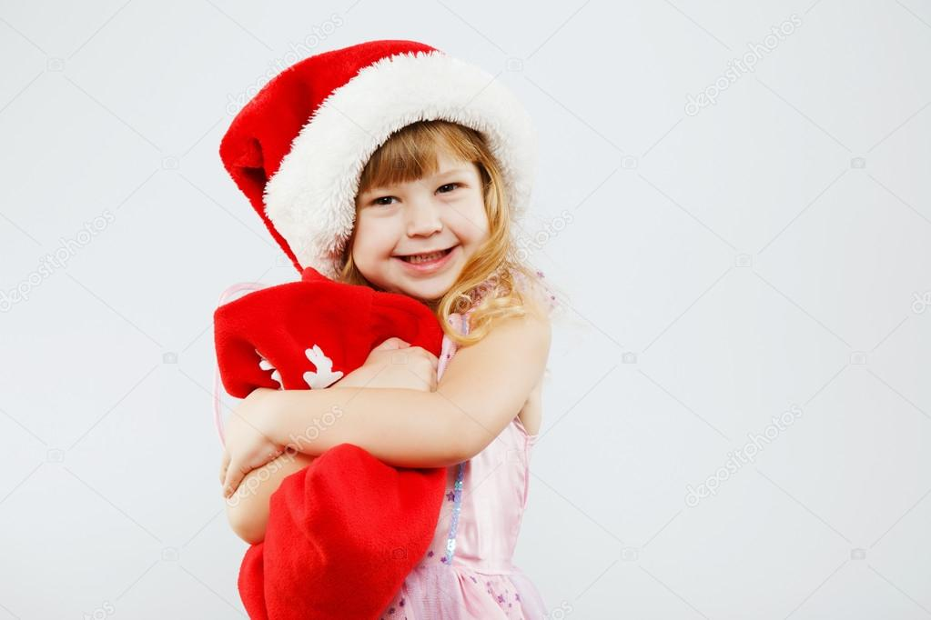 af7882763 Happy little girl posing with red bag — Stock Photo © VelesStudio ...