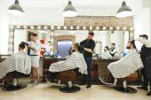 Fotografie Barbers doing haircuts for clients