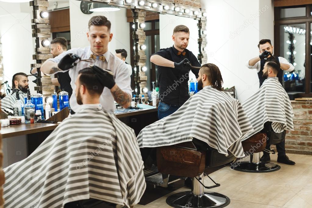 Men At Barber Shop Doing Haircuts Stock Photo Velesstudio 115665990