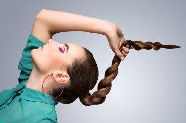 Girl holding her braid