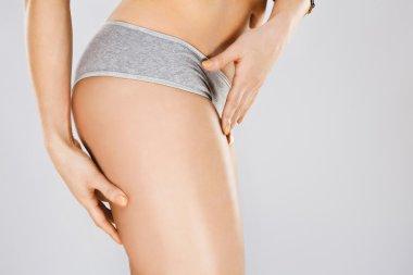 Fit girl's body in gray underwear