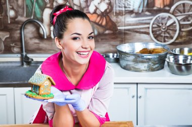 Girl confectioner leans on the wooden cooking board
