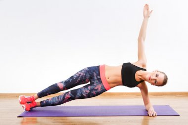 Pretty girl doing physical exercises