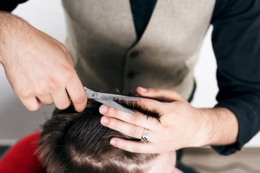 Barber giving a new haircut