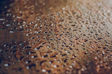 Raindrops on a wooden surface