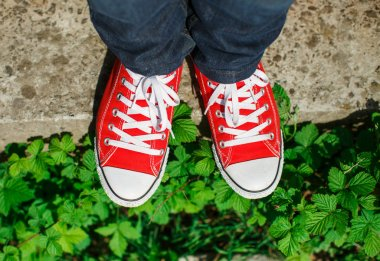 Red shoes on concrete