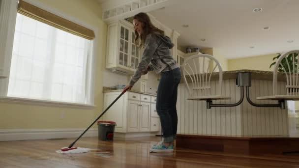 woman mopping kitchen floor — stock video © silverlake #84255908