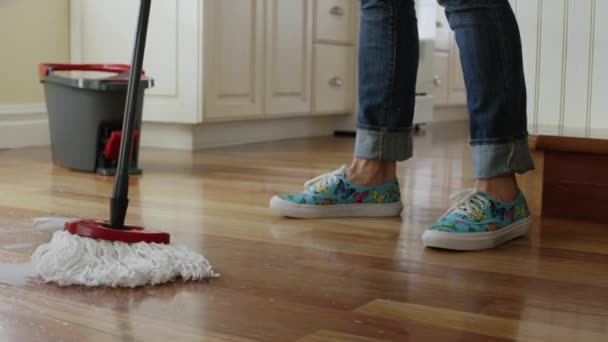 Woman mopping kitchen floor — Stock Video © Silverlake #84279284