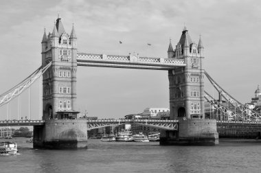 LONDON, GREAT BRITAIN - MAY 18, 2014. Tower Bridge over River Thames in London, with historic buildings, boats and people.