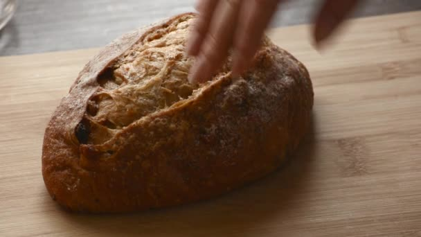 Baker hands touching the bread on table