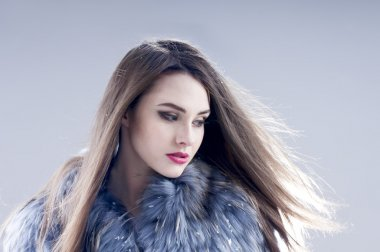 Winter fashion woman in a fur coat