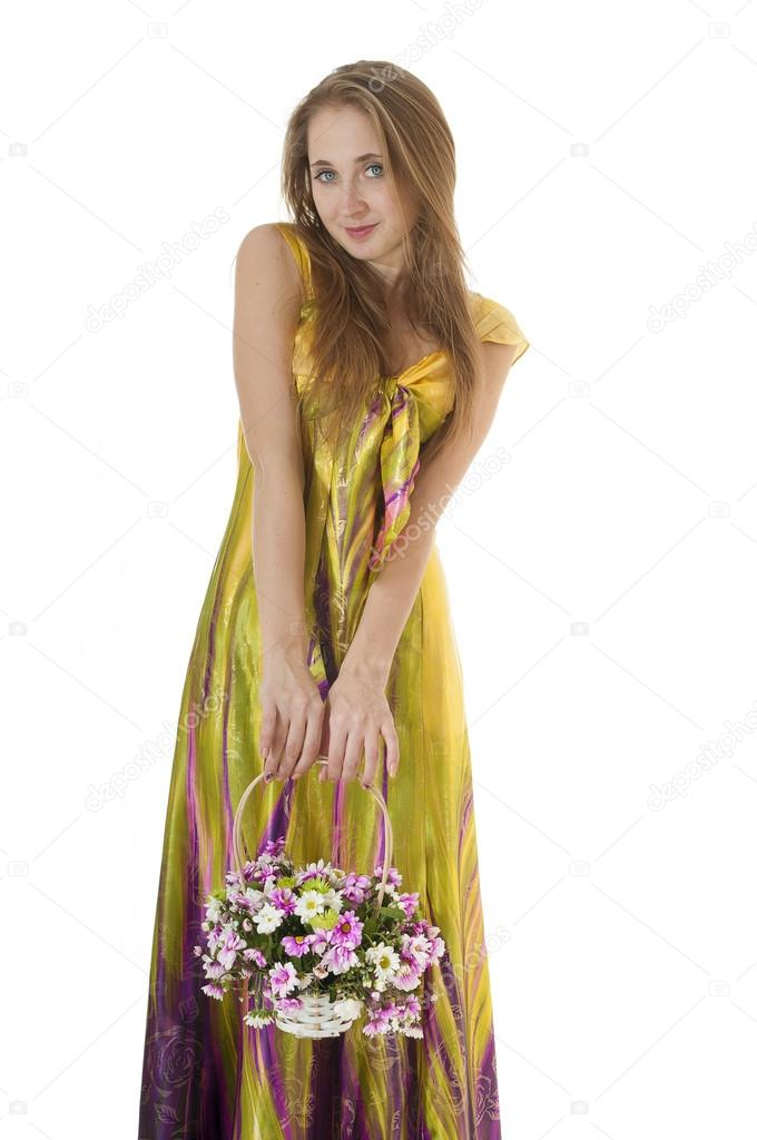 Portrait of a happy spring  girl with  a basket of flowers