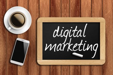 coffee, phone and chalkboard with digital marketing words