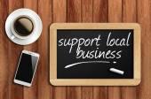 Kaffee, Telefon und Tafel mit Unterstützung regionaler Betrieb Wörter