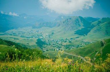 Village among green hills