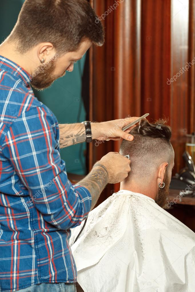 Handsome Man Getting New Haircut In A Barber Shop Stock Photo
