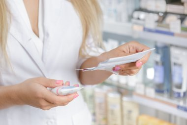 Close up of a pharmacist checking the prescription