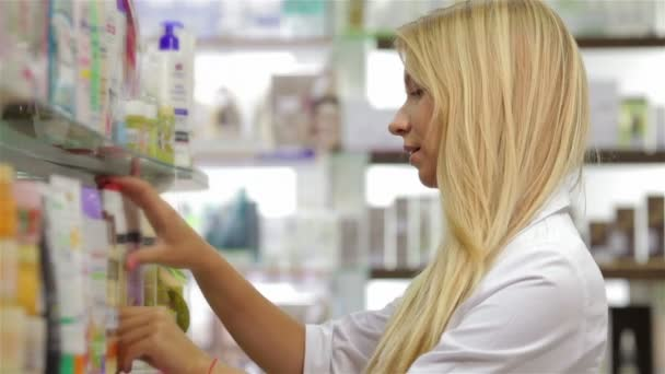 Pharmacist fronting the product in drugstore