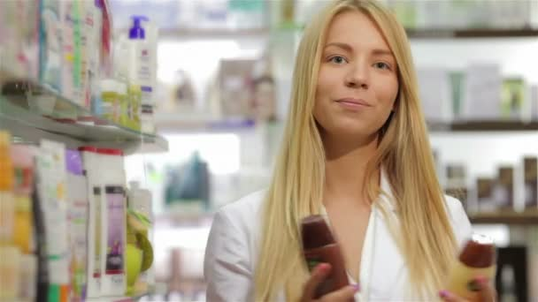 Portrait of a beautiful pharmacist holding product