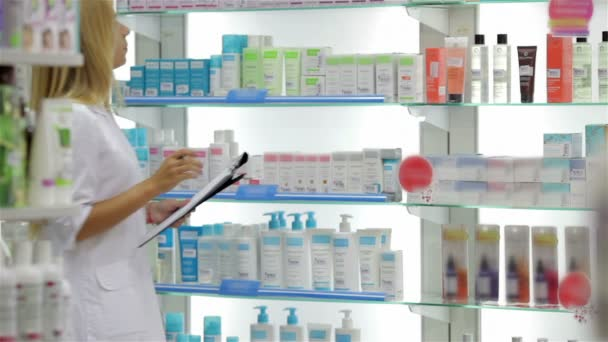 Pharmacist accounting the product in drugstore