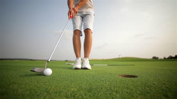 Golfer making a putt