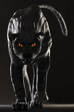 Evil looking cyborg black panther with red glowing eyes walking towards camera