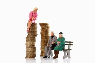 Figurines of old age pensioner sitting on bench,beside young wom