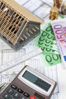 Model house calculator euro notes on blueprint, planning constru