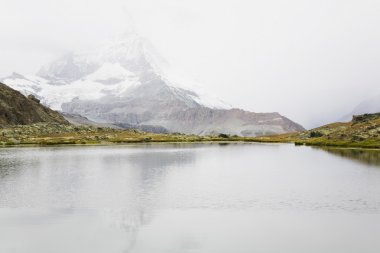 Switzerland, Valais, Alps, Matterhorn, Lake and fog