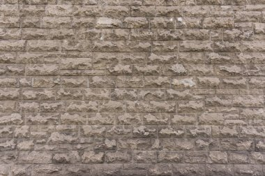 Outside wall made of bricks, texture background