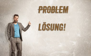 Mature business man pointing up towards text, problem and soluti