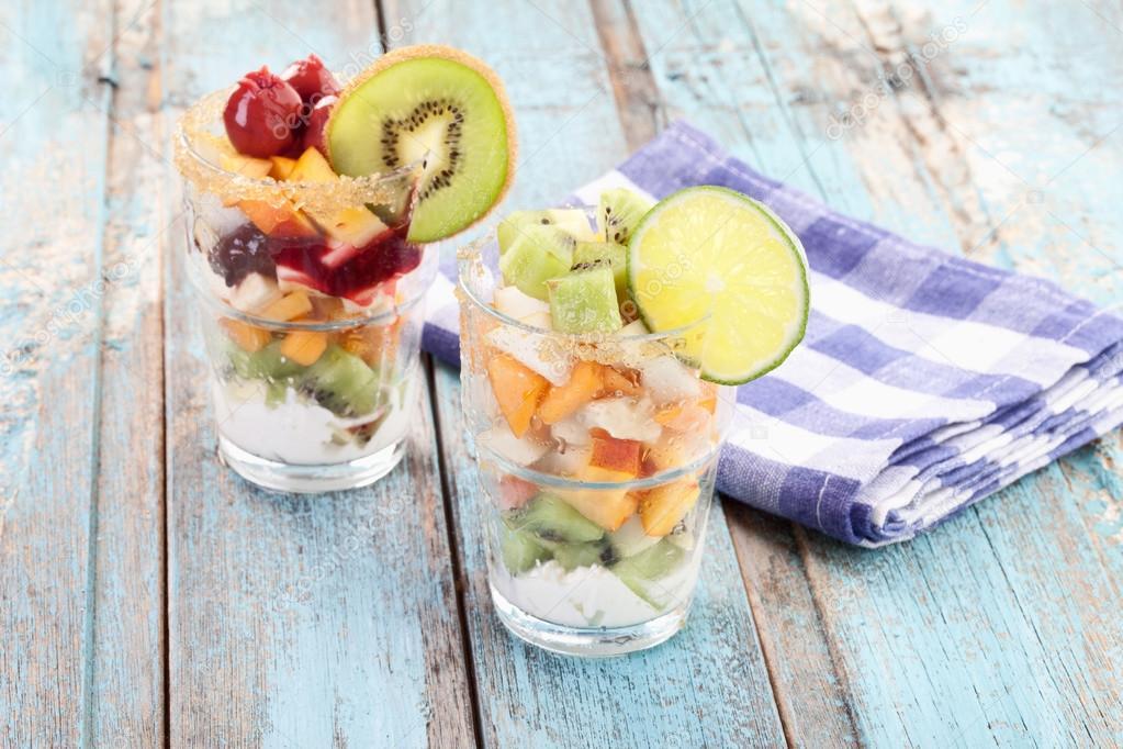 Close up of fruit salads near checked napkin
