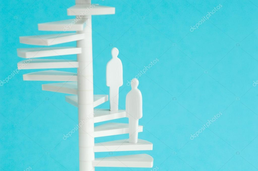 Figurines on spiral stair