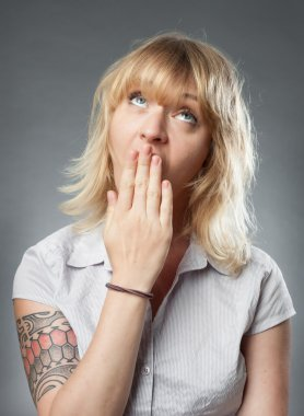 Young women portrait on grey background, bored yawning expressio