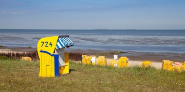 Germany, Cuxhaven, dyke and beach, hooded beach chair