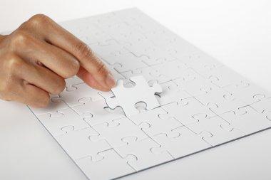 Hand finishing white puzzle