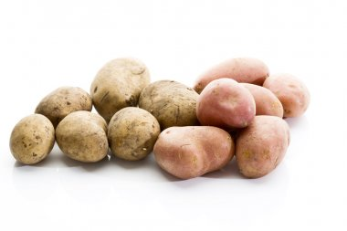 Different types of potatoes on white background